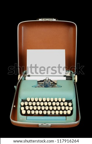 portable manual typewriter in case; isolated on black - stock photo
