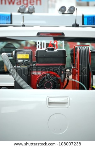 Portable petrol generator on a white fire truck - stock photo