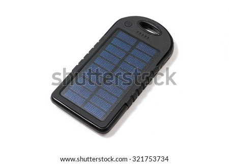 Portable solar charger for smart phone. Power bank isolated on white.