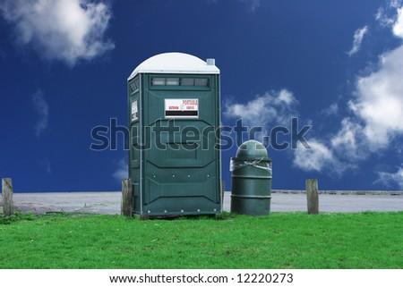 Portable toilet at a park - stock photo