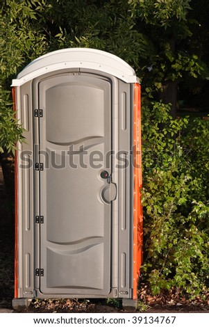 Portable Toilet in the Park. - stock photo