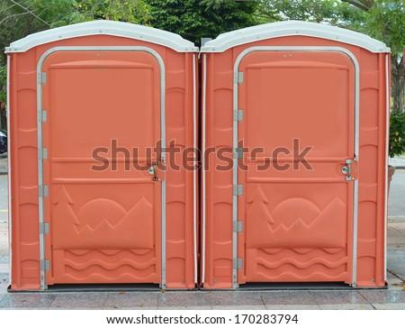 Portable Toilets orange Color  - stock photo
