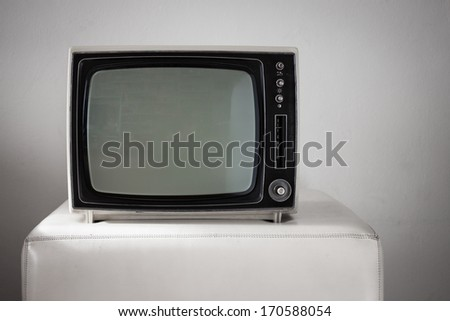 Portable vintage television on white background