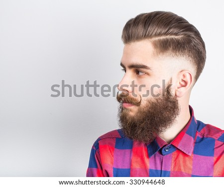 Portait of a handsome hipster guy over white background.