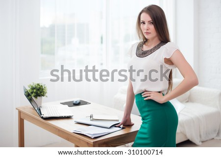 Portait of beautiful successful business woman standing at office