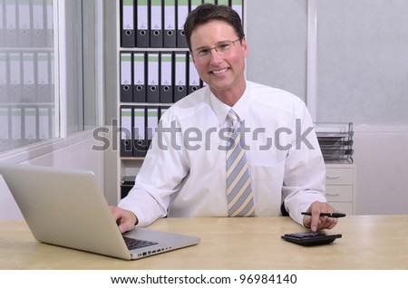 portait of financial advisor at office - stock photo