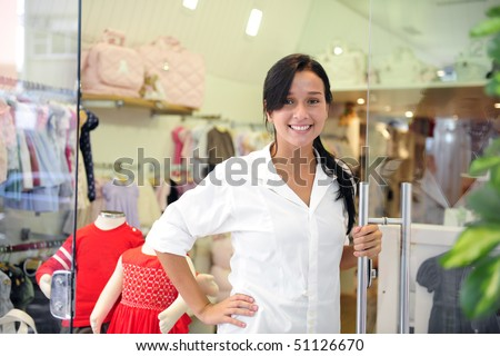 portait of small business owner: proud woman opening her  children clothing store