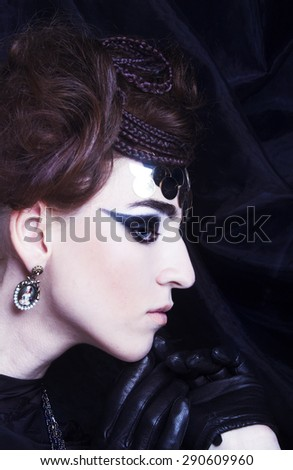 Portait of young stylisn woman with creative visage. - stock photo