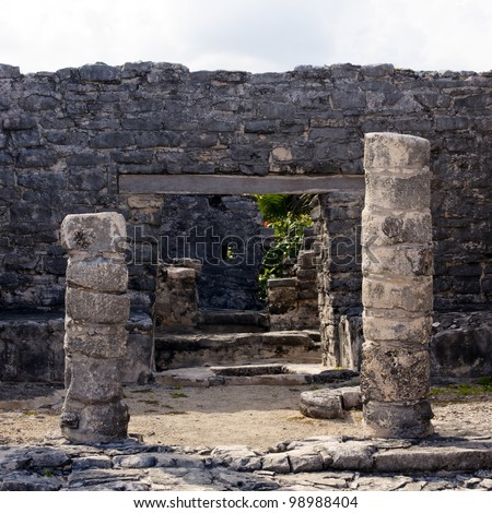 Portal into Mayan ruins at the archeologcal zone in Tulum, Quintana Roo, Mexico. - stock photo