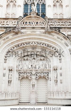 Portal on the facade of the the Brou Monastery - stock photo