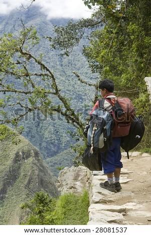 Porter for the inca Trail in Peru - stock photo