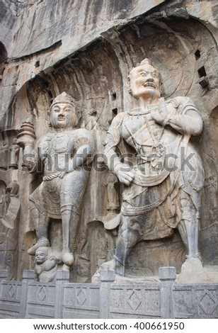 Porter's statue rock carving at Longmen Grottoes, Luoyang, Henan, China