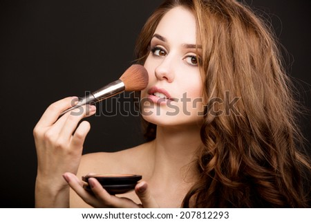 portert beautiful girl holding in a hand brush for makeup