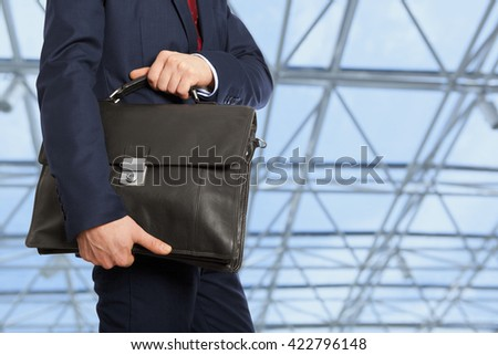 Portfolio investor. Businessman with briefcase  - stock photo