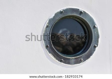 Porthole in the white hull of passenger ship. Marine background - stock photo