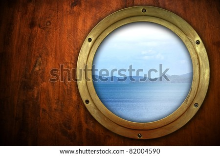 porthole with ocean view - stock photo