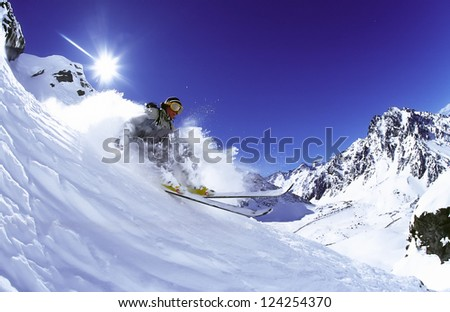 PORTILLO, CHILE - SEPTEMBER 15: Skier Christian Thorstensen skiing fresh powder snow in the winter in Portillo on September 15, 2000. Portillo is a popular winter resort in the Andes Mountains. - stock photo