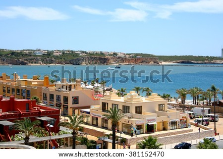 Portimao, Portugal - June 24, 2009: View on central part small hotel village with palms on  famous beach Praia da Rocha in Portimao, Algarve Province in Portugal. Atlantic ocean is on the background - stock photo