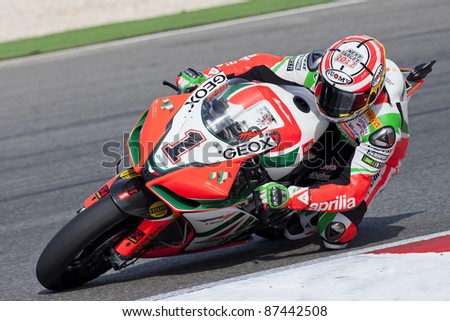 PORTIMAO, PORTUGAL - OCTOBER 16: A closeup of Max Biaggi, the third place winner of world Superbikes Championship in Algarve, Portimao on October 16, 2011. - stock photo