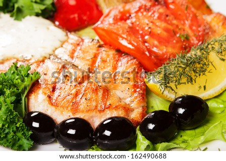 Portion baked fish with vegetables and spices
