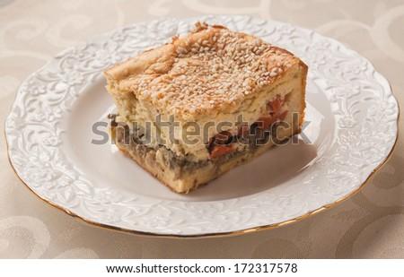 Portion cheese and mustard souffle stuffed with vegetables on a plate - stock photo