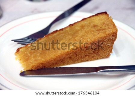 Portion of almond tart on plate