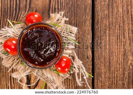 Portion of Barbeque Sauce (close-up shot) on dark rustic background - stock photo