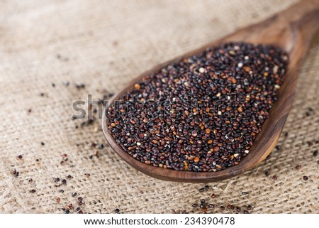 Portion of black Quinoa (detailed close-up shot) on rustic background
