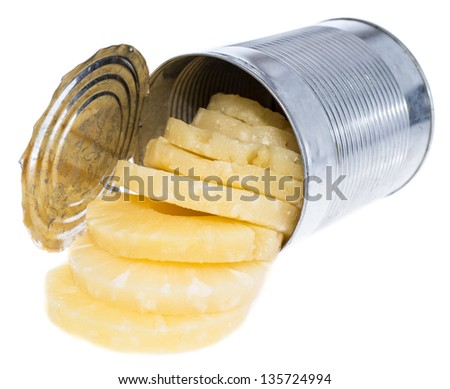 Portion of canned sliced Pineapple in a tin isolated on white background - stock photo