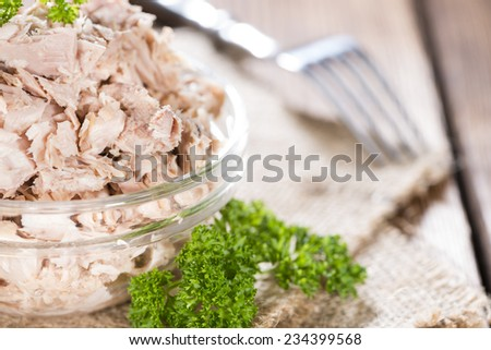 Portion of (canned) Tuna with fresh herbs as detailed close-up shot - stock photo