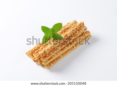 portion of cheese sticks decorated with piece of mint - stock photo