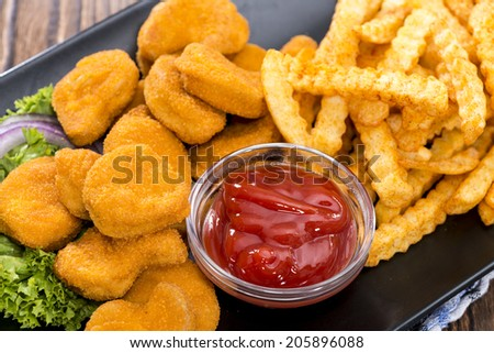 Portion of Chicken Nuggets with Chips (detailed close-up shot) - stock photo