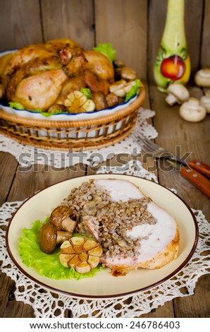 Portion of chicken stuffed with buckwheat with mushrooms on wooden table