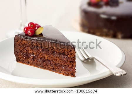Portion of chocolate cake served on a table - stock photo