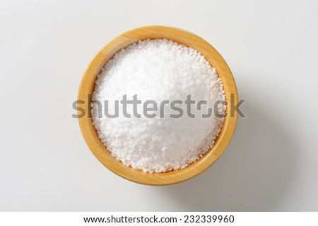 portion of coarse salt in the wooden bowl - stock photo