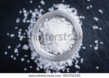 Portion of Coarse Salt on vintage background (selective focus; close-up shot) - stock photo