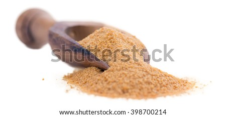 Portion of Coco Sugar (close-up shot) isolated on white background