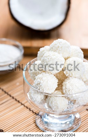 Portion of Coconut Pralines on wooden background