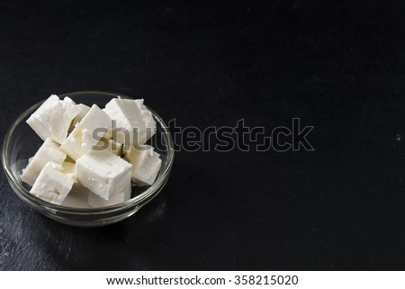 Portion of creamy Feta Cheese on a slate slab (close-up shot)