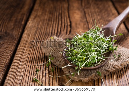 Portion of Cress (close-up shot) on rustic wooden background - stock photo