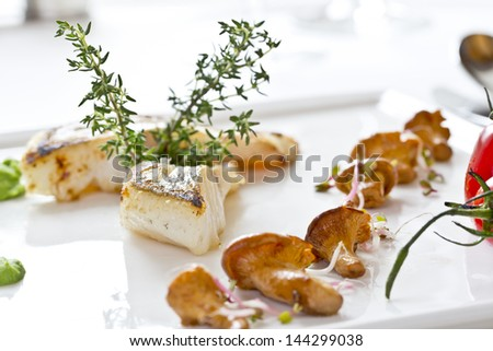 portion of delicious fish with chanterelles - stock photo