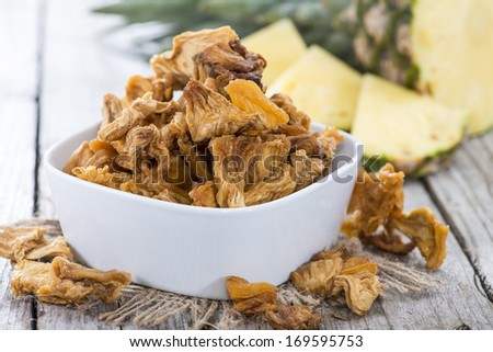 Portion of dried Pineapple (close-up shot with some fresh fruits)
