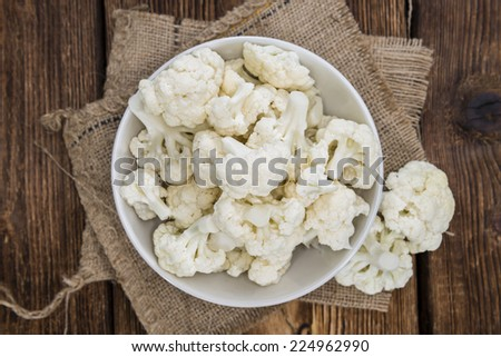 Portion of fresh Cauliflower on wooden background - stock photo