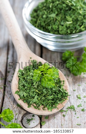 Portion of fresh dried Parsley (close-up shot)