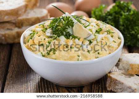 Portion of fresh homemade Egg Salad with fresh herbs - stock photo