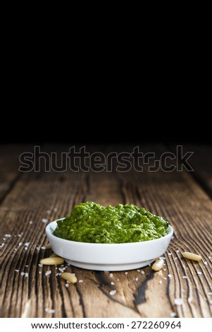 Portion of fresh homemade Ramson Pesto on rustic background - stock photo