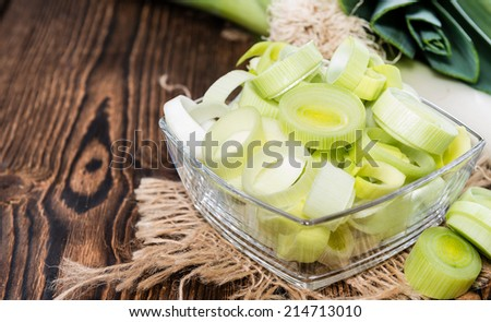 Portion of fresh Leek on dark background (close-up shot)