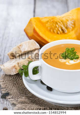 Portion of fresh made Pumpkin Creme Soup - stock photo