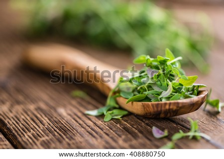 Portion of fresh Thyme (close-up shot) on wooden background