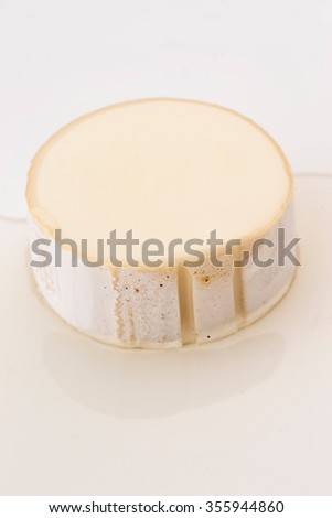 portion of goat cheese sprinkled with olive oil - stock photo